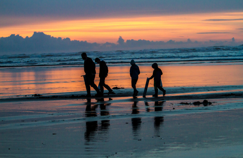Family walking on beach at Oceanfront Getaways.