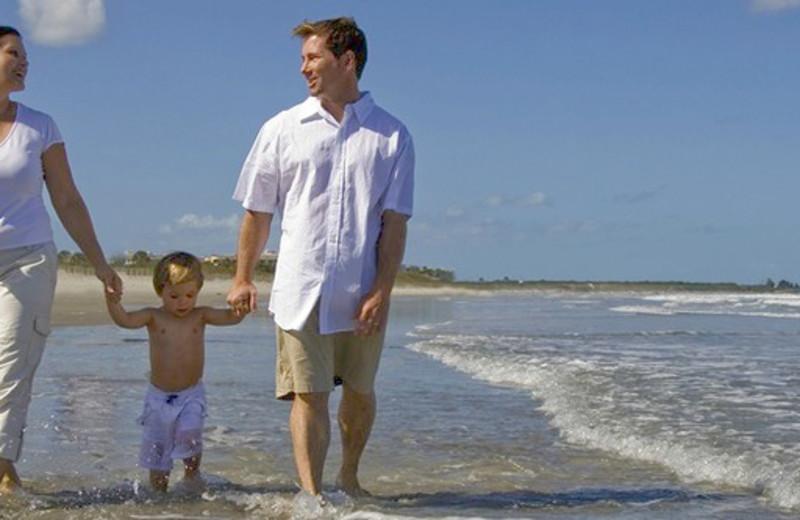 Family on beach at Beach Walk Oceanfront Inn.