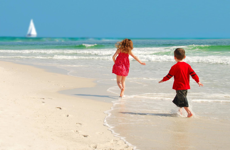Kids playing on the beach at Perdido Key Resort Management.