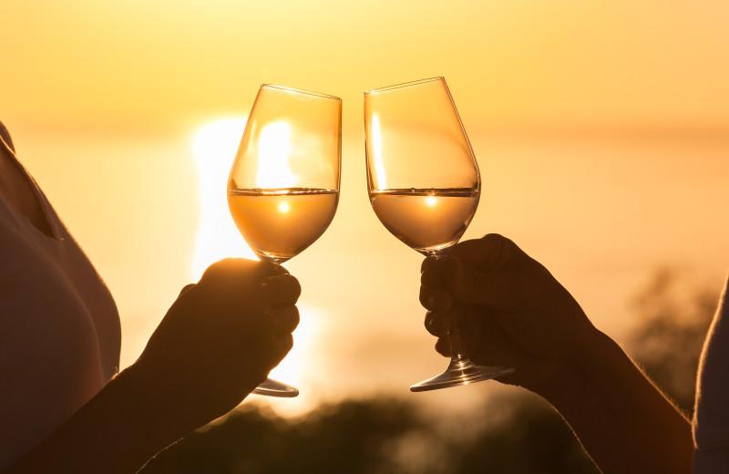 Couple toasting at Adobe Resort.