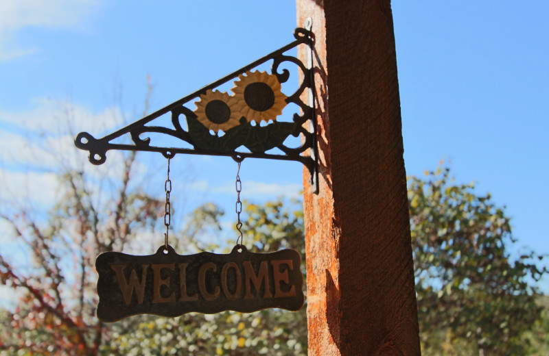 Welcome sign at Ozark Cabins.