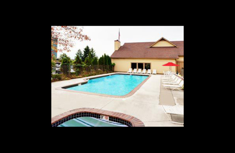 Outdoor pool at Hawthorn Suites Detroit Southfield.