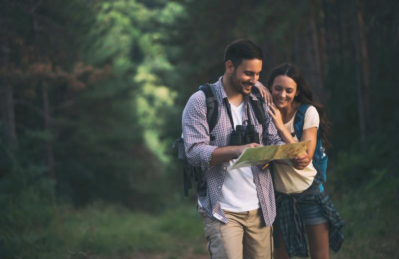 Couple hiking at Sisters Vacation Rentals.