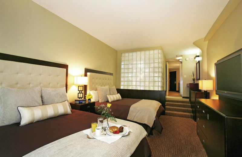 Guest room at The Atheneum Suite Hotel.