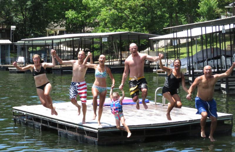 Jumping in lake at Point Randall Resort.