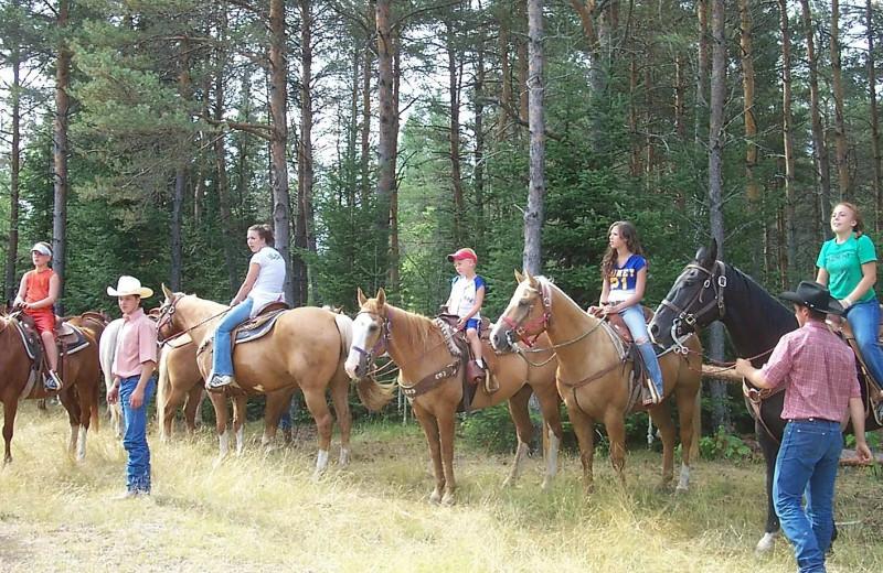 Horseback riding at Holiday Acres Resort.
