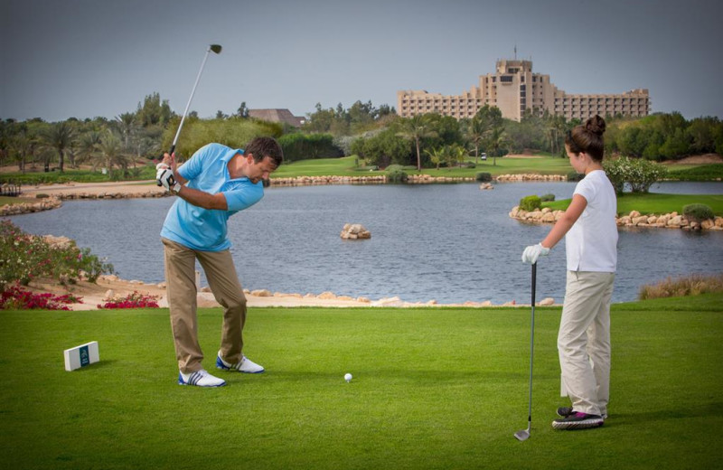 Playing golf at Jebel Ali Hotel and Golf Resort.