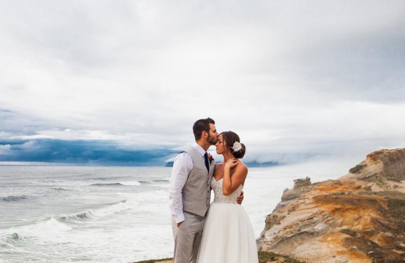 Wedding couple on beach at Inn at Cape Kiwanda.