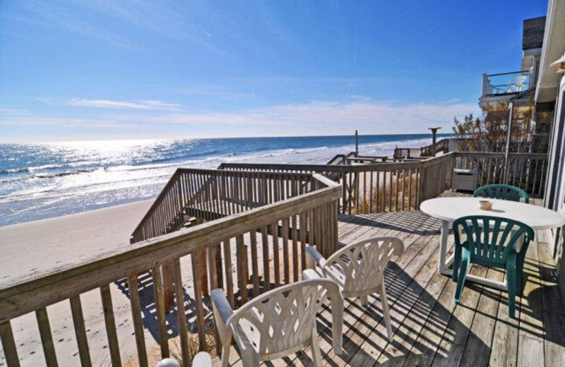 Vacation rental deck at Century 21 Action Inc.