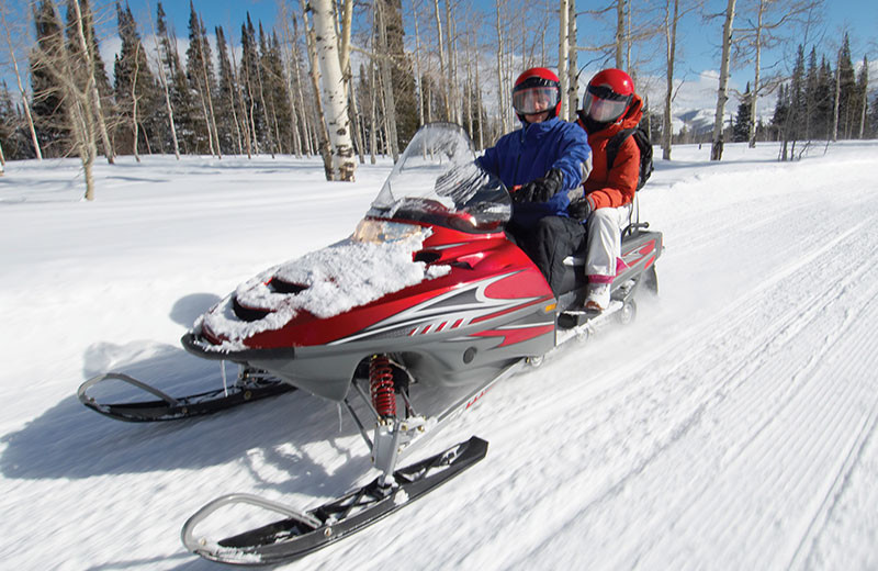 Snowmobiling at Grand Colorado on Peak 8.