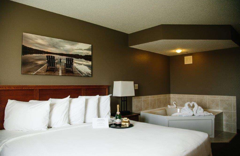 Guest room with hot tub at GrandStay Perham.