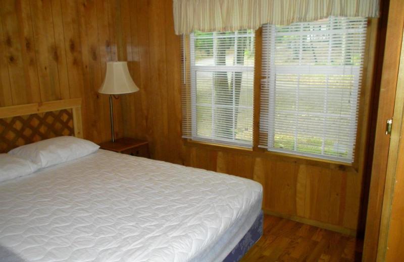 Cabin bedroom at Lake Ridge Resort.
