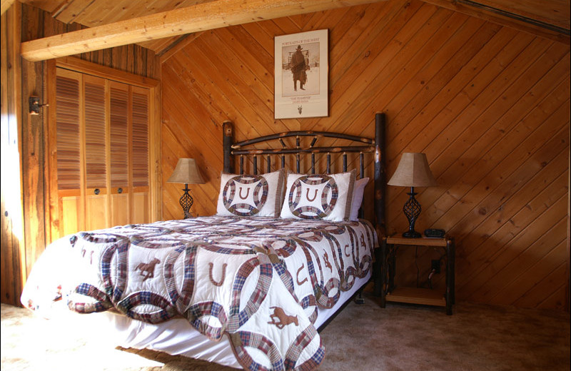 Cabin bedroom at Rand Creek Ranch.