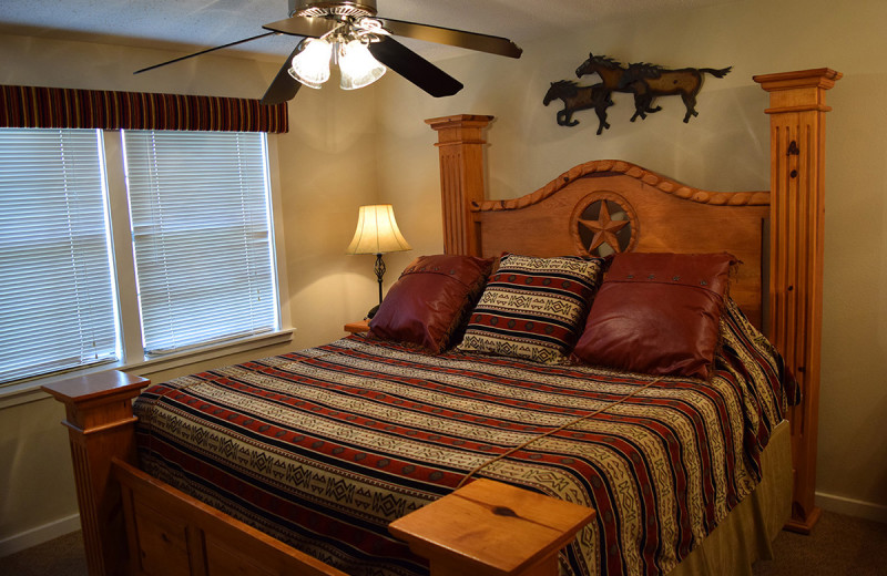 Guest bedroom at Flying L Hill Country Resort & Conference Center.