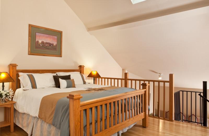 Country Oak Loft bedroom at HideAway Country Inn.
