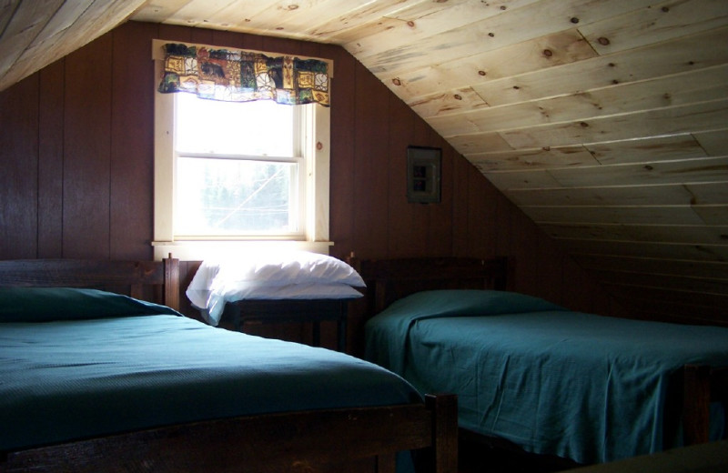 Cabin bedroom at Wilsons On Moosehead Lake.
