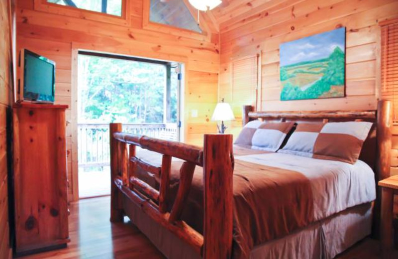 Cabin bedroom at Mountain Getaway Cabin Rentals.