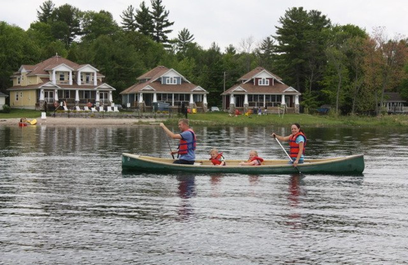 Family canoeing at Bayview Wildwood Resort.