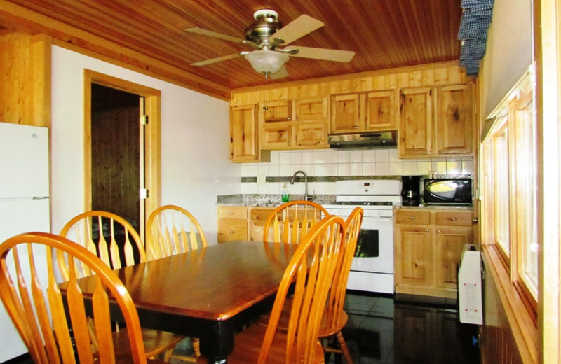 Cabin kitchen and dining area at Contessa Resort.