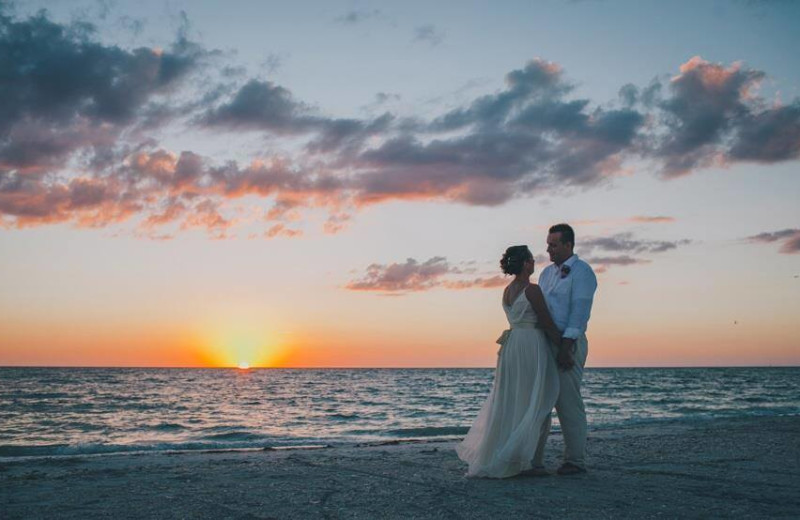 Wedding couple on beach at Palm Island Resort.