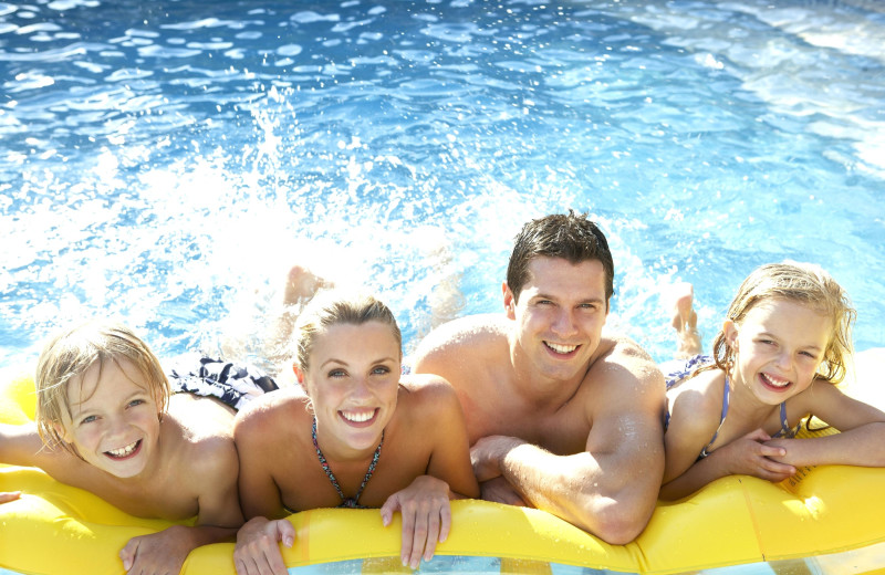 Family in pool at Island Club Rentals.
