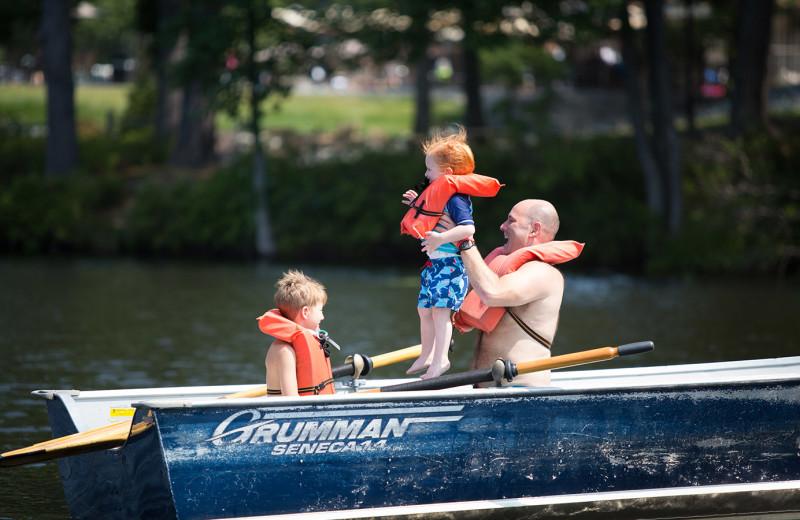Family boating at Woodloch Resort.