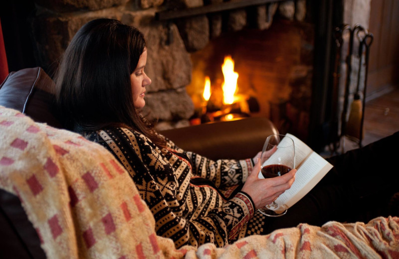 Relaxing by the fire with a book at The Point.