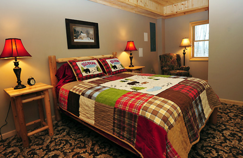 Vacation rental bedroom at Timberline Mountain-Access Properties.