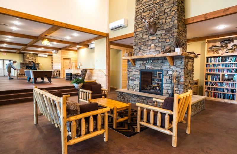 Game room in the lodge, showing pool table, foosball and large gas fireplace.