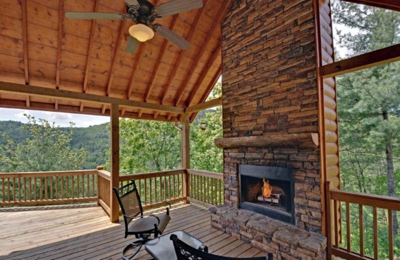 Deck view with fireplace at Southern Comfort Cabin Rentals.
