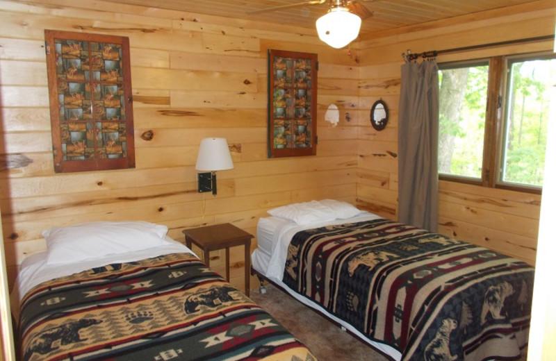 Cabin bedroom at Cedar Point Resort.