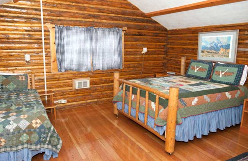 Cabin bedroom at Triangle X Ranch.