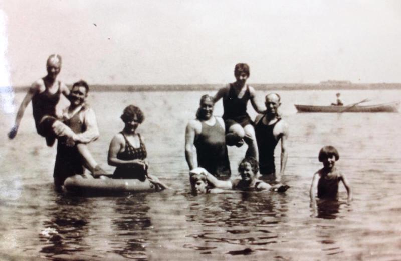 Historic photo of family swimming at Bonnie Beach Resort.