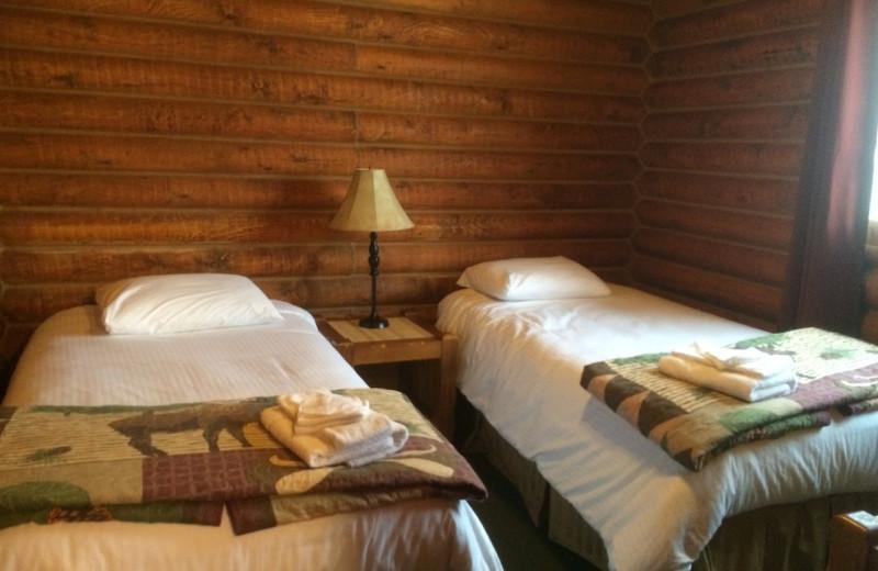 Cabin bedroom at Bakers Narrows Lodge.