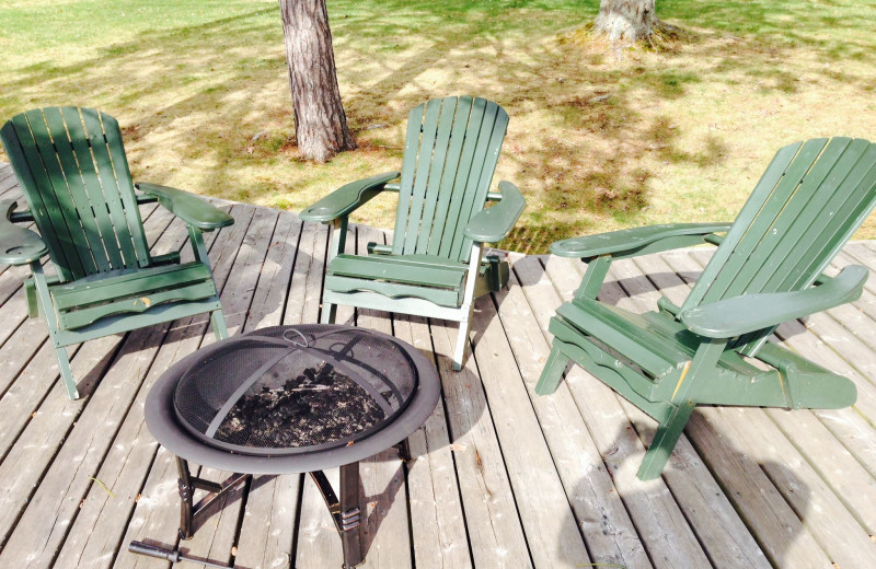 Fire pit on the dock overlooking the lake to enjoy each evening at Heather Lodge.
