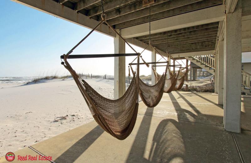 Rental hammocks at Reed Real Estate Vacation Rentals.