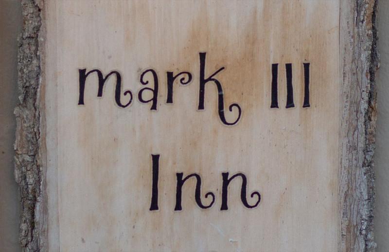 Welcome sign at Mark III Inn.
