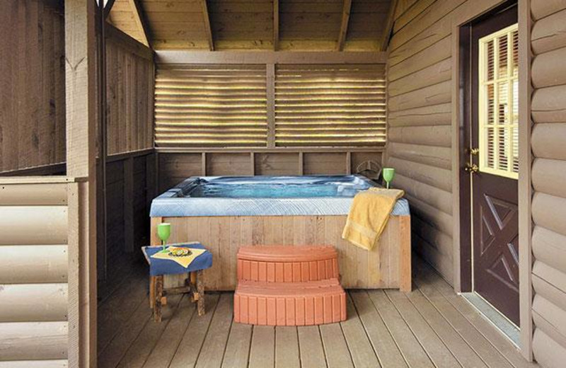 Rental hot tub at Country Pines Log Homes.
