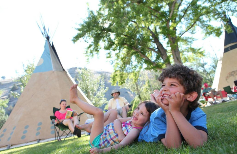 Family by teepees at Kah-Nee-Ta Resort and Spa.