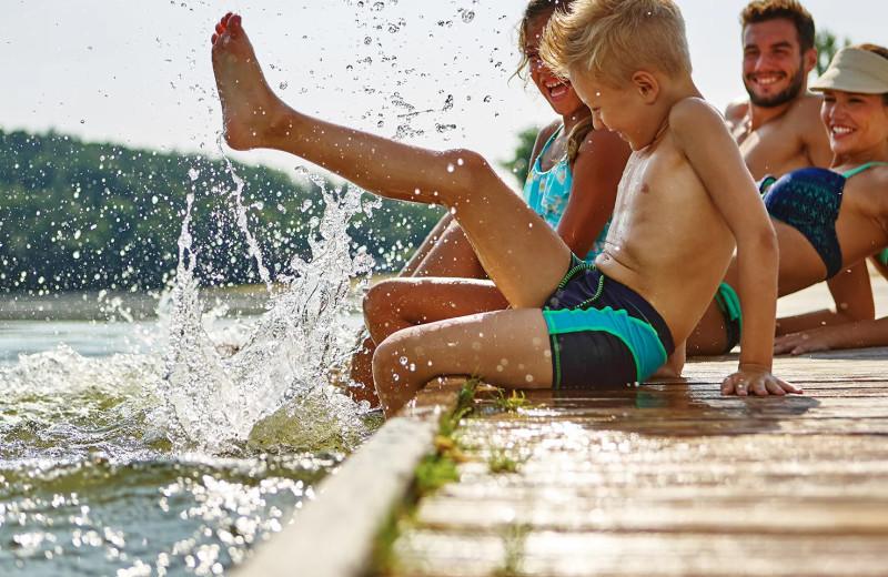 Family on dock at Bayview Wildwood Resort.
