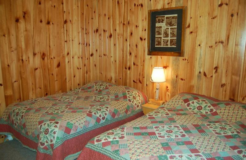 Cabin bedroom at Bear Paw Resort.