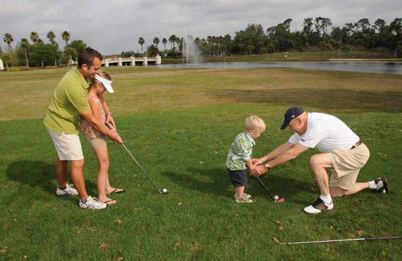 Family playing golf at Star Island Resort.