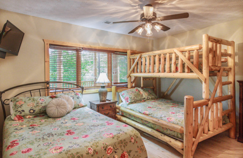 Rental bedroom with bunk beds at Stony Brook Cabins, LLC.