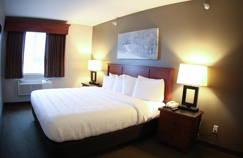 Guest room at GrandStay Perham.