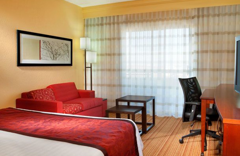 Guest room at Courtyard by Marriott Dallas Central Expressway.