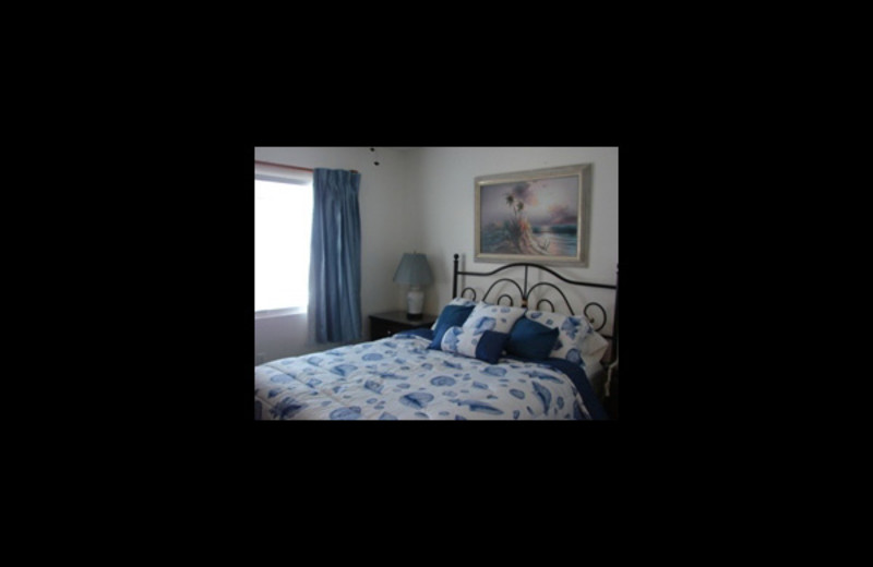 Rental bedroom at Four Seasons Vacation Rentals.
