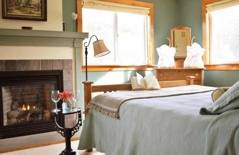 Guest room with fireplace at The Red Clover Inn & Restaurant.