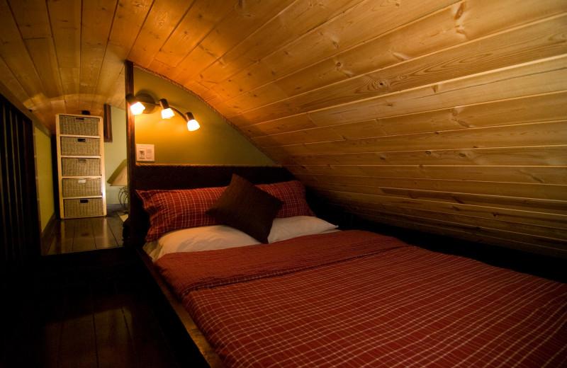 Cabin bedroom at Cedar House Restaurant & Chalets.