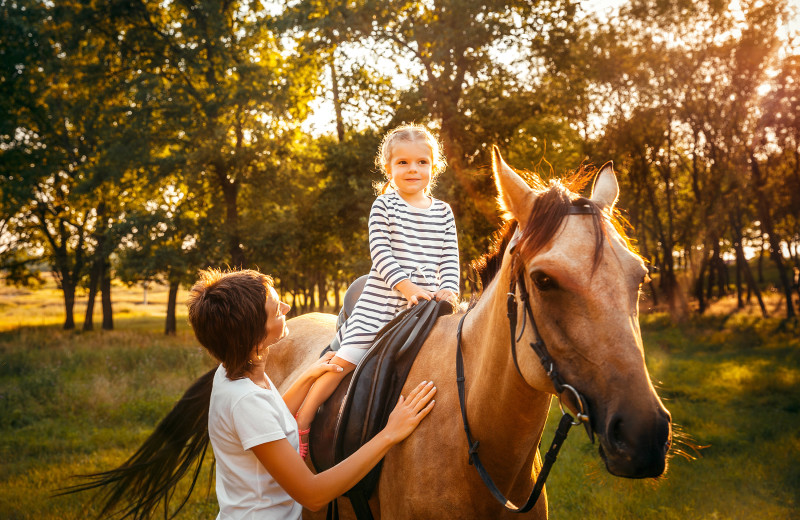 Horseback riding at Creeks Crossing Cabins.