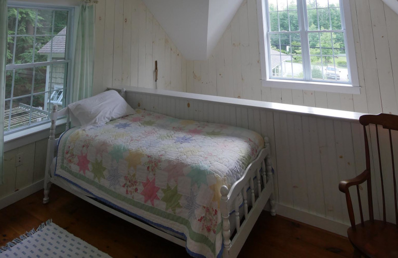 Cottage bedroom at Sunapee Harbor Cottages.